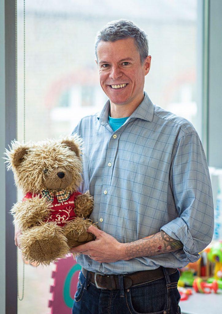 Caspar Addyman holding a teddy.