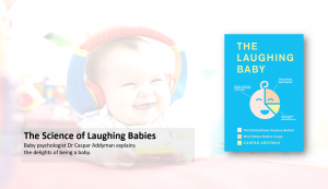 Laughing baby in background with book in foreground